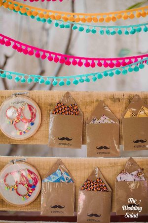 Pocket squares   tassel earrings   mehndi favours that your guests will use