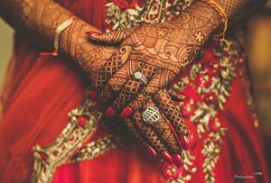 Bride showing her engagement ring romesh dhamija