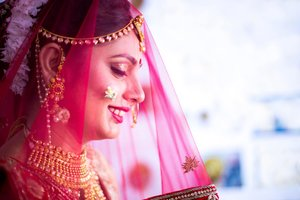 Jodhpur bride in veil close up side shot wedding candid photo