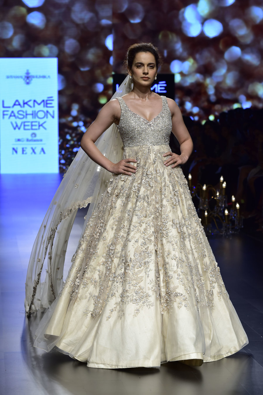 082129fab767 Kangana rocked the fairytale-look in in that ivory gown by Shyamal    Bhumika. The dupatta attached to her bun brings the 90s look back with such  class.