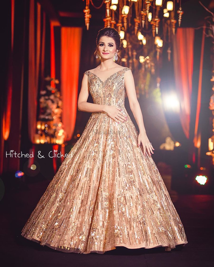 fb1df24b969 Stealing hearts in that shimmering gold gown by Manish Malhotra and minimal  accessories