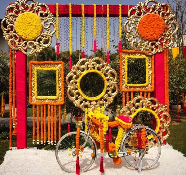 Photo booth ideas for indian wedding fabric flowers cycle idea