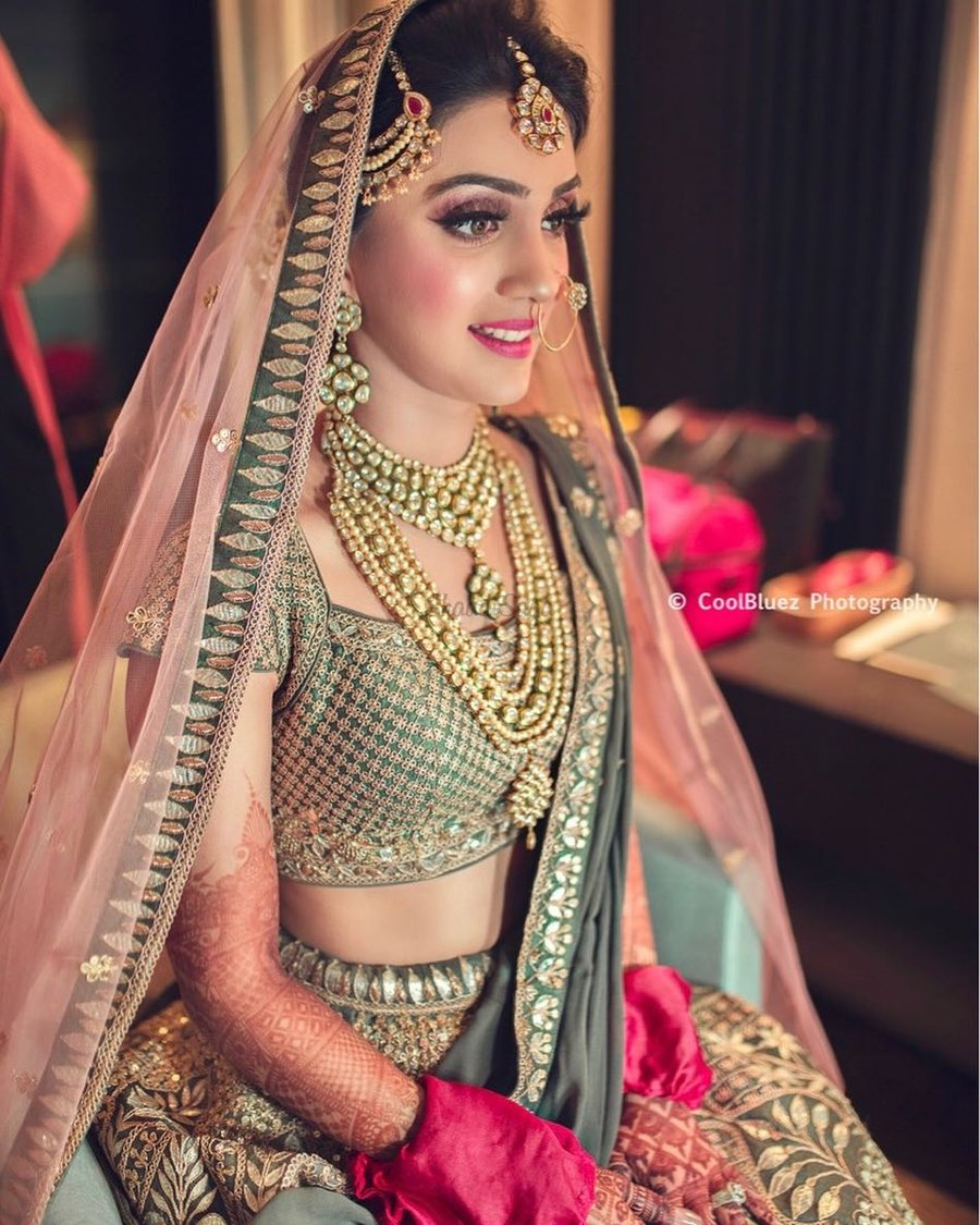 43f21bcffb Olive green lehenga with golden and silver thread work paired with light  pink dupatta