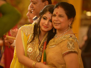 Candid bride with mother