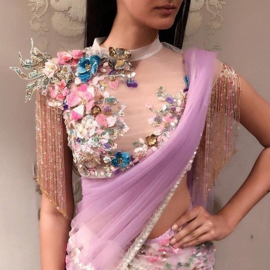 f0f4f6b1840af High neck blouse with crystalized tassel details