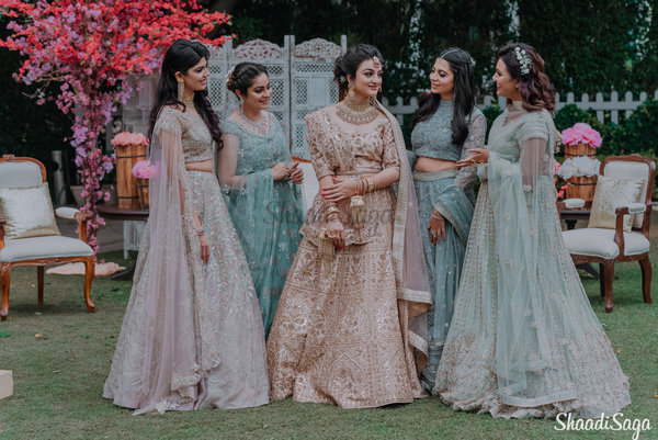 A Whimsical Bride & Bridesmaids Shoot in Worldly Pastel Outfits & Rustic Decor