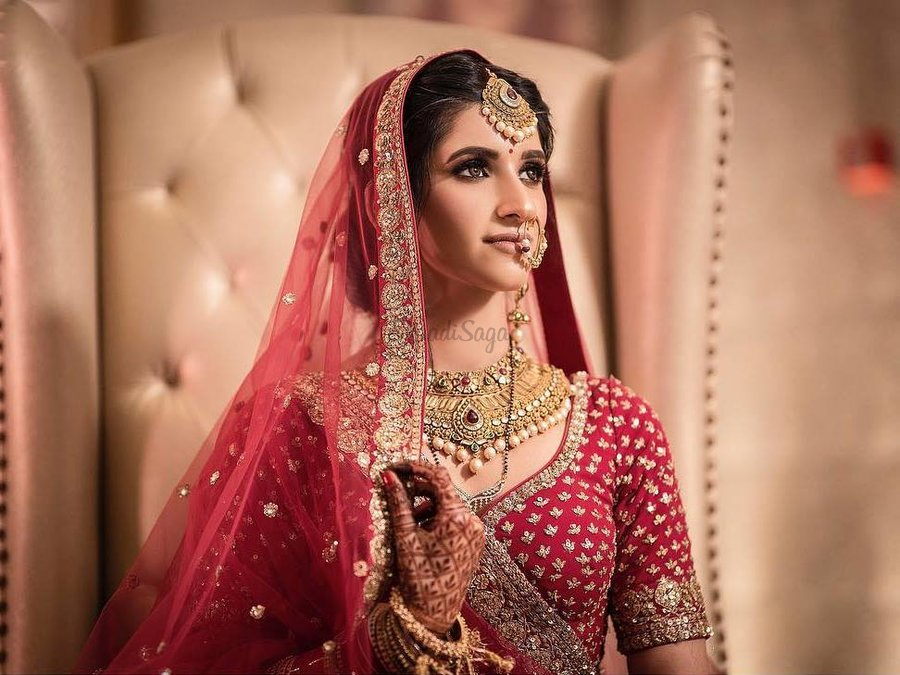 Brides are teaming their red lehengas with nude lipsticks more than ever  before