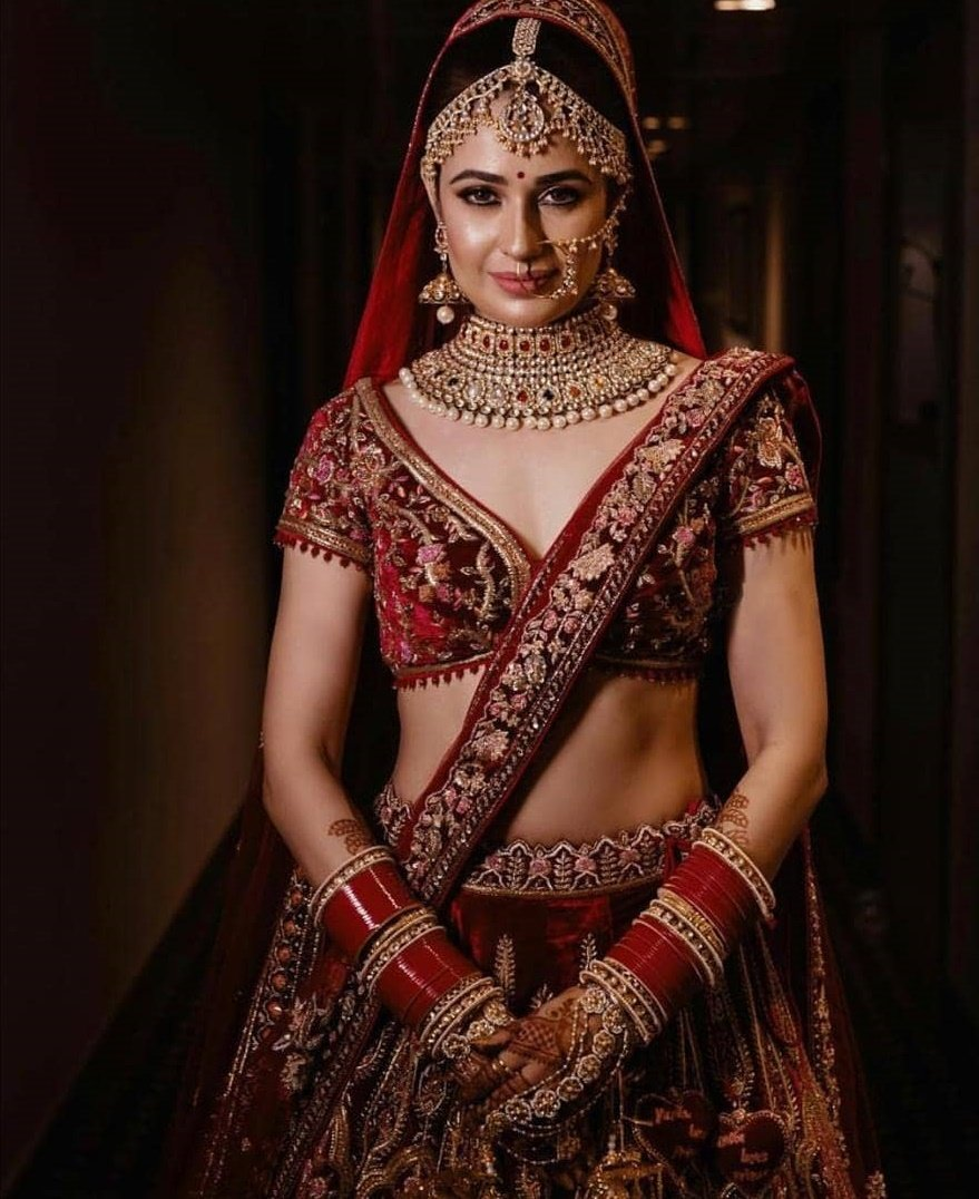 3cf83d74e9 TV actress Yuvika Chaudhary opted for a lehenga in a deeper hue of red