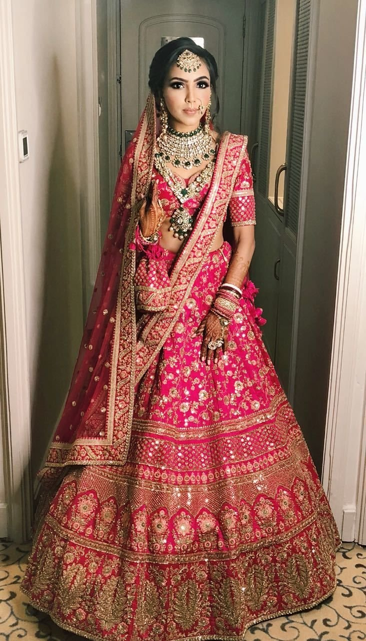 37813cfbf9ce Sabysachi collection 2018 was a dream come true for brides; this Rani pink  lehenga with golden embroidery is a proof!