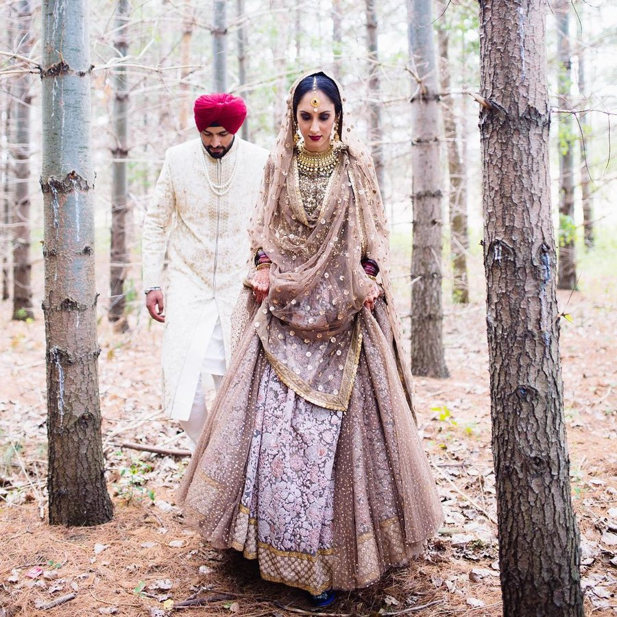 e5eab39a6c0d A breathtakingly beautiful lavender bridal outfit with heavy threadwork  embroidery spread across the entire expanse of the lehenga.