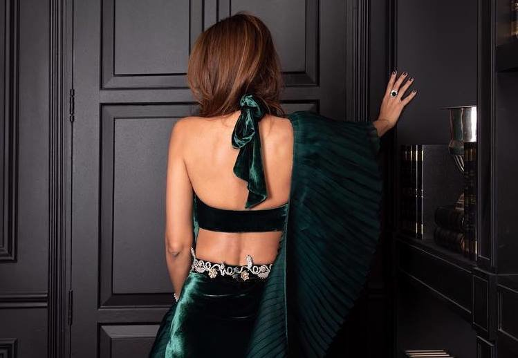 https://www.amazon.in/gp/search/ref=as_li_qf_sp_sr_il_tl?ie=UTF8&tag=fashion066e-21&keywords=backless blouse&index=aps&camp=3638&creative=24630&linkCode=xm2&linkId=070608727c18071facfb99de01af38b0