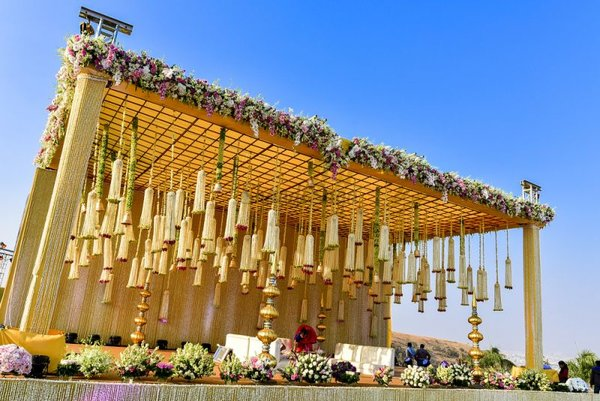 Beautiful mustard and white floral decor with hanging florals  wedmegood  suraj   supriya  wedmegood  indianweddings  decor  florals  hangingdecor  hangingflorals  white  yellow  weddingday